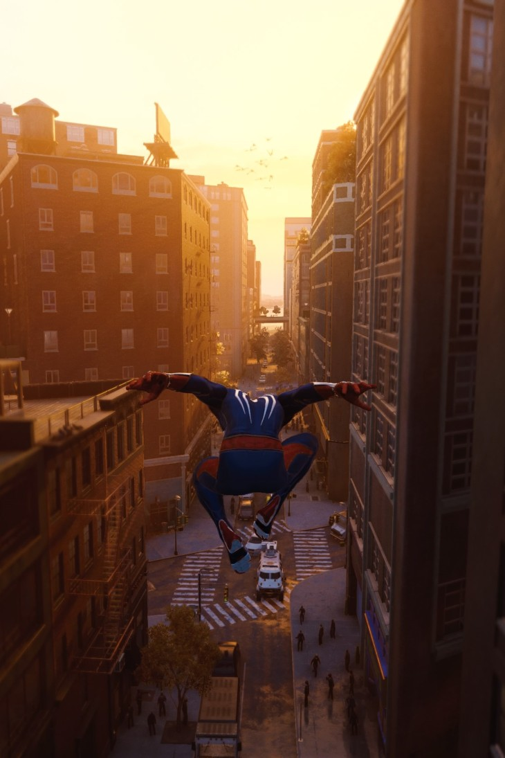 In-game graphics of Spider-Man travelling through the city streets.